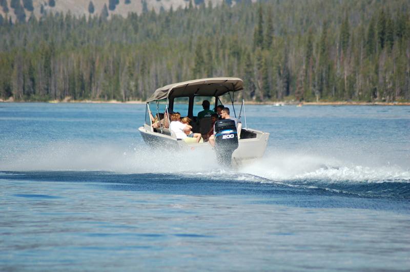 boat driving on lake