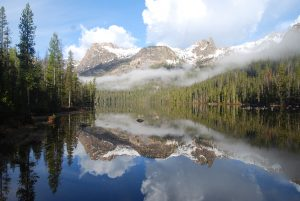 Hell Roaring Lake With Haze Hovering On Mountain Peaks