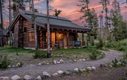 Honeymoon Cabin in the woods with a path in front of it