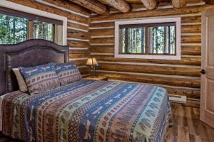 Cabin 29 bed at Redfish Lake Lodge
