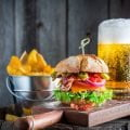 Beer and fresh hamburger made of beef, cheese and vegetables