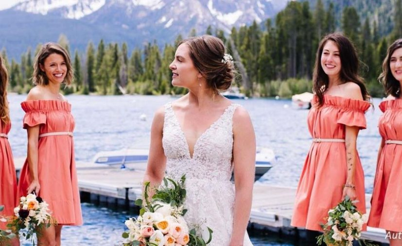 Bride and bridesmaid in front of Sawtooth Mountains